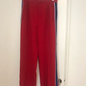 Red track pants with blue stripe